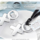 "http://www.warmimpressions.com - ""Hugs & Kisses from Mr. & Mrs."" Chrome XO Bottle Opener - Item: 11120NA - 75% OFF"