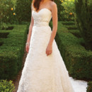 Style 2048 Soft Tulle over Silky Satin with 3D Soft Tulle flowers and Swarovski crystals, rhinestone, and pearl beaded trim finished with a rolled hem. Pleated Tulle sweetheart bodice is accented with a ruched band and crystal buttons on zipper.