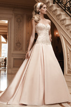 Style: 2123 Stunning beadwork and embroidery adorns the sweetheart strapless bodice. Box pleats at the dropped waist give this ball gown extra fullness. Matching fabric covered buttons continue the full length of the train. This gown features an inside hook and eye fit panel.