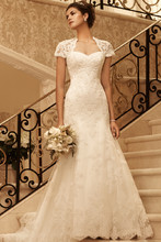 Style 2102 This gown has an attached short sleeve Queen Anne neckline with keyhole back. Sweetheart neckline is trimmed with pleated organza. Beaded lace fit and flare gown is finished with an eyelash fringe scalloped hemline.