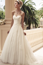 Style 2108 Strapless sweetheart neckline with Soft Tulle ruched bodice. The skirt is a gathered A-line silhouette. The Soft Tulle overlay features non-beaded lace appliqués scattered throughout the gown.