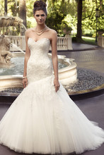 Style 2116 Embroidered lace gown with silver embroidery accents. Strapless sweetheart neckline and a full asymmetrical trumpet skirt.