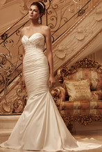 Style 2118 Ruched, stretch Perfecting Satin sweetheart neckline. Front and back bodice is accented with a Swarovski Crystal, pearl, and rhinestone beaded appliqué. Matching fabric covered buttons with loops line the zipper of this mermaid shaped gown.
