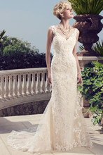 """2155 Sheer lace """"V"""" shaped tank top with a slim mermaid skirt. The non-beaded lace overlay continues over the sweetheart neckline to create traditional lace straps. Re-embroidered lace appliqués and raw edge add character to this non-beaded lace gown."""