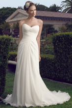2157 A great destination gown! The slim A-line silhouette features a strapless sweetheart neckline and lattice pleated bodice, finished with crystal buttons along the zipper. Silky Charmeuse lines the inside of the gown with the soft Silky Charmeuse against the skin.