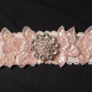 Handmade blush garter embellished with rhinestones and sequins.
