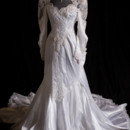Gorgeous Vintage wedding gown with elaborate lace and bead work.
