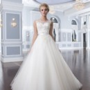 Style 6295 This lace ball gown has an illusion Sabrina neckline that is trimmed with satin. Thenatural waist is accented with a regal satin belt featuring streamers. Tulle buttonsenclose the V-back neckline and cover the back zipper. This wedding dress is finishedoff with a flowy chapel length train.
