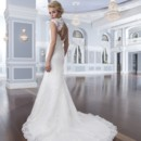 Style-Back 6298 Corded lace and tulle create the Mandarin neckline and cap sleeves on this fit and flare gown. The back of the dress has a surprising keyhole back neckline with tulle covered buttons over the back zipper that continue through the chapel length train.