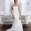 Lillian West 6327 Strapless beaded Alencon lace and laser cut organza asymmetric fit and flare gown with Alencon lace accents. The back is finished with a corset and a chapel length train.