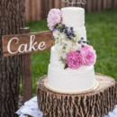 4 tier cake decorated with fresh peonies and a personalized wire topper.