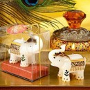 Good Fortune Elephant Candle Favor brings Far Eastern flair to your wedding reception, Hand decorated white candle with deep rich burgundy and gold accents. Bring Good Luck and fortune to your special Day. Beautifully gift boxed.