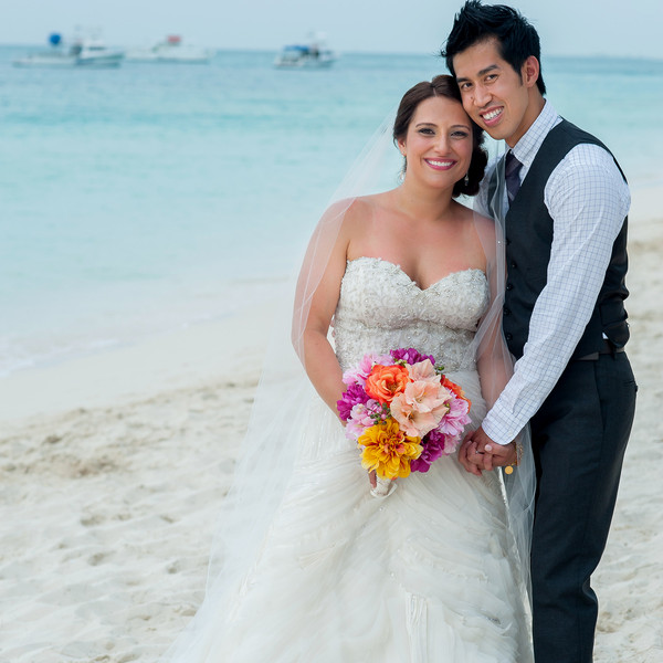 Venue: Beaches Resort  Dress Designer: Lazaro  Dress Store: Mia Bridal Co.  Day-After Dress Designer: David's Bridal  Bridal Shoes: Vivienne Westwood  Tuxedo and Men's Attire: J. Crew  Tie: Burberry  Veil: Sara Gabriel Veiling and Headpieces  Floral Designer: Hibiscus Florals