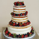 Naked wedding Cake. Coconut Cake with lemon curd filling, decorated with fresh berries.