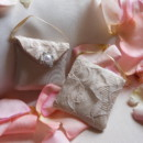 Bridal shower favors!! Little purses of champagne shantung covered with lace! Trimmed with pearl and rhinestone clasp...gourmet candy inside!