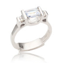 Emerald Cut diamond ring with round diamond accents designed by Spectrum Art & Jewelry