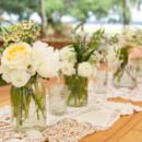 Venue: Marshlands  Event Designer: Ashley Rhodes Events  Floral Designer: Wildes Floral Design  Equipment Rentals: Amazing Event Rentals  Dress Designer: Vera Wang  Band: Tayo Reed Band
