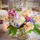 <p> Reception Venue and Caterer: The Michigan League at University of Michigan</p>  <p> Floral Designer: Magnolia, A Fresh Flower Market, Inc.</p>  <p> </p>
