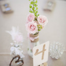 <p> Venue: CJ's Off the Square</p>  <p> Floral Designer: Enchanted Florist</p>  <p>  </p>