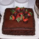 Chocolate cake filled and iced with chocolate buttercream and topped with chocolate dipped strawberries