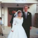 Our first wedding in December of 2001. Was a small wedding at a little country church. The theme was a winter wonderland theme. The bouquet was gorgeous . Made of snow tipped white roses and ice blue and royal blue poinsettias. The Matron of Honor and Bridesmaids wore ice blue and royal blue and carried one single white snowtipped rose rapped in a royal blue ribbon.