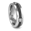 This 7mm wide titanium ring has an industrialized look to it. Inlaid in the center is a strip of black titanium cable which goes all the way around the ring. Evenly spaced there are four titanium barrel connectors.
