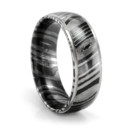This TIMOKU ring is 7mm wide, has a slightly rounded profile and dropped edges that are high polished. Ring is comfort fit as well. One of our more popular wedding bands for guys. Most sizes are not in stock and are custom made for you when you order.