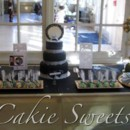 Elegant Sweets table with wedding ring cake. Includes Rocher topiaries, cake pops, and personalized fondant covered sugar cookies.