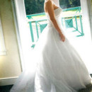 130x130 sq 1373577700074 tampa palms golf and country club bride gazing out windowalbumdetail