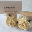 Beautiful french vanilla cream roses with ivory and pearl satin ribbon make these place card holders simply timeless, and will be beautiful in any wedding or rehearsal dinner. This listing is for a set of 10 natural birch wood place card holders for $35.00 They are 2 inches tall, and approximately 2 - 2 1/2 inches wide. Each holder has a 3/8 inch slot on the top which holds the place card nicely. Each piece is hand crafted so no two are alike! Use these at weddings, rehearsal dinners, baby showers, and really any party event that you want some additional sparkle to your table. Mixing and matching styles is a beautiful table design statement. if you don't see what you are looking for, just send us a message and we are happy to create that special look for you. Keep it rustic chic! Tutti Rose Designs Be sure to visit www.etsy.com/shop/tuttirosedesigns to see our entire collection.