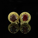Garnet Earrings 14K Yellow Gold http://www.orospot.com/product/e279ma/garnet-earrings-14k-yellow-gold.aspx SKU: E279MA $210.00 Round garnet stud post Earrings 14K yellow gold are 8 mm measured in diameter. Gem Weight: Approx. 1.2 cttw (both earrings) This style is also available in white gold and a variety of other gems such as: Citrine, Blue Topaz, Amethyst and Peridot. Please contact us if you are interested in any of these options.