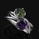 14K White Gold Triple Twisted Shank Amethyst Green Tourmaline Modern Engagement Ring http://www.orospot.com/product/r2000ven/14k-white-gold-triple-twisted-shank-amethyst-green-tourmaline-modern-engagement-ring.aspx SKU: R2000VEN $499.00 This 14k gold ring contains prong set, round amethyst (.80ct) and green tourmaline (approx .82ct). Triple twisted shank is 3 mm wide on the bottom, 5.5 mm wide on the split shank part, top of the ring is 12.5 mm wide, the stones are set above the finger 6.5 mm. Ring was designed to accommodate 6 mm stones and is also available in variety of other gemstones. Please contact us if you are interested in any of these options.