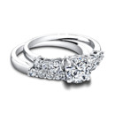 The Jayne Set (ring 0.54ct ttl; band 0.30ct ttl ) Intriguing intensity. Round diamonds in a shared prong setting give the Jayne Wedding Set its extraordinary fire and presence. The Jayne Engagement Ring draws all eyes toward your center stone. And the matching band is a stunning companion, with its own brilliance and seamless fit. Please inquire with your authorized retailer for more or less diamonds. Hand crafted in either Platinum, 18k Gold, or 14k Gold.