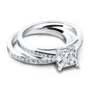 The Hannah Set (ring 0.35ct ttl; band 0.37ct ttl) An enchanting and feminine wedding set. The Hannah Engagement Ring's channel set, princess cut diamonds are exquisite, paired with a delicate millgrain finish. The Hannah Wedding Band is made to match with princess diamonds, and a low profile that lets your engagement stone stand out and be noticed. Hand crafted in either Platinum, 18k Gold or 14K Gold.