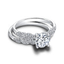 The Lola Set <br /> (ring 0.13 ttl; band 0.05 ttl) Entwined in love. The Lola Set features flowing, nature-inspired embellishments. Your center stone is surrounded by intricate detail and dazzling accent diamonds. Can be custom made to fit any shape center stone. Hand crafted in either Platinum, 18K Gold or 14K Gold.