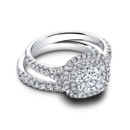 The Tara Set (ring 0.49 ttl; band 0.28 ttl) Breathtaking is the only word that comes close. A perfectly coordinated set, with all the intricate detail, sublime form and stunning brilliance you could wish for. Your center diamond is surrounded by a double halo. Can be custom made to fit any shape center stone. Hand crafted in either Platinum, 18K Gold or 14K Gold.
