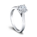 The Gloria Engagement Ring (0.05ct ttl) A striking masterpiece. A tapered shank calls attention to Gloria's dazzling round solitaire. The delicate pavé
