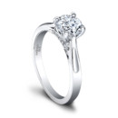 The Gwen Engagement Ring (0.10ct ttl) The epitome of elegance and charm. Gwen presents its bold round center diamond with a flourish. The solitaire is highlighted by the ring's tapered shank, pavé