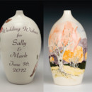 "Wedding Wish Vase© hand formed and painted porcelain vase to receive your keepsake messages. Featuring ""White Birch Trees"" decoration with trees and mountains. Personalized with the couples' names and wedding date. Comes with poem encouraging heartfelt notes from wedding guests. Easily opened becoming a treasured keepsake."
