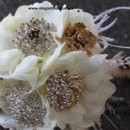 A classy brooch bouquet with feathers