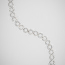 Promise Ring Tennis Bracelet <br /> Slim, pavé silver rings deck out this bracelet for plenty of classic sparkle; the rings seamlessly link together for a sleek, modern look.