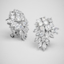 Conifer Cluster Stud  <br /> An array of round and marquise crystals drips from this stud earring, for a sparkling effect with just the slightest touch of holiday flair.