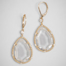 Crystal Shard Drops <br /> Add some interest to your bridal get-up with these eccentric statement earrings, characterized by an angular-cut gem, set in thin gold accented in crystals.