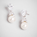 Akoya Bouquet Drops <br /> The ivory pearl might have been sheltered by an oyster for years, but its properly home is officially nestled under a cluster of delicate crystals. These sleek drops are all ladylike with just a dash of glam.