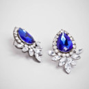 Sapphire Bouquet Studs  <br /> A delicate bouquet of crystals is the perfect foil to a bold sapphire-hued gem. These ornate drops back plenty of punch worn solo, and are equally easy as an addition to other baubles.