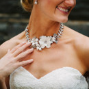 Ceremony Dress Designer: Martina Liana from Hannelore's Bridal Boutique  Jewelry: PARIS by Debra Moreland