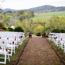 """<strong class='info-row'>Andrew Morrell Photography</strong> <div class='info-row description'><html>  <head></head>  <body>    Rentals:   <a href=""""http://www.weddingwire.com/biz/prime-time-party-rental-dayton/7591dd09850756f7.html?utm_source=ww&utm_medium=photo-gallery&utm_campaign=real-weddings"""" target=""""_blank"""">Prime Time Party Rentals</a>  Officiant: Rand Waldron  Venue: The Inn at Mount Vernon Farm    <div>     <div>  Ceremony Musicians: Jackass Flats     </div>    </div>    <div>        </div>   </body> </html></div>"""