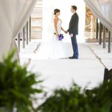 "<strong class='info-row'>Andrew Morrell Photography</strong> <div class='info-row description'><html>  <head></head>  <body>    Dress Designer:   <a href=""http://www.weddingwire.com/wedding-photos/dresses/allure-bridals?utm_source=ww&utm_medium=photo-gallery&utm_campaign=real-weddings"" target=""_blank"">Allure</a>  Hair & Makeup Artist:   <a href=""http://www.weddingwire.com/biz/alison-harper-company-llc/96266e0368b4a84a.html?utm_source=ww&utm_medium=photo-gallery&utm_campaign=real-weddings"" target=""_blank"">Alison Harper and Company</a>   </body> </html></div>"