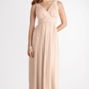 Julie A surplice v-neck and flattering twisted waist detail highlight this bra-friendly gown. Available in other colors