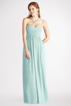 Laura A sweetheart neckline accents this delicate chiffon gown. Features an interior corset and padded cups Available in other colors